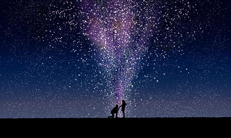星空の下でサプライズプレゼントを渡すイメージ